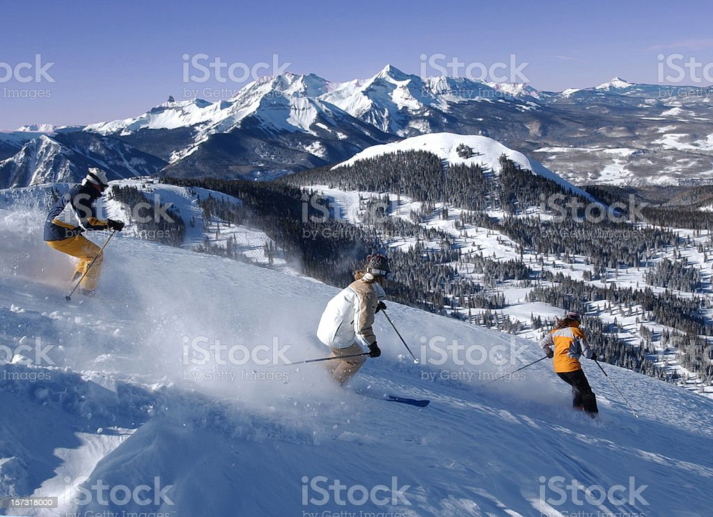 Three friends skiing fresh powder royalty-free stock photo