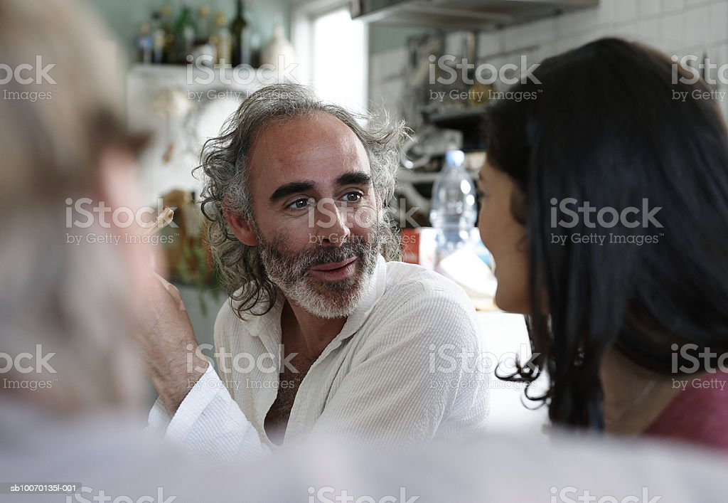 Three friends talking at home royalty-free stock photo