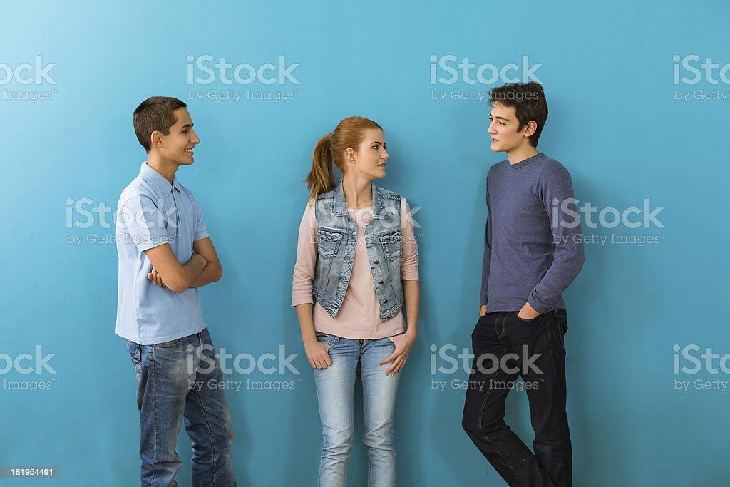 Three friends talking stock photo