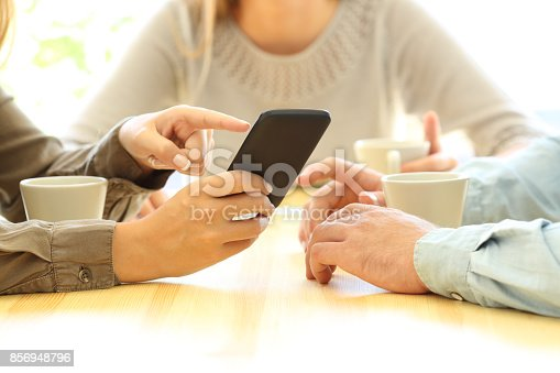 istock Three friends watching media in a smart phone 856948796