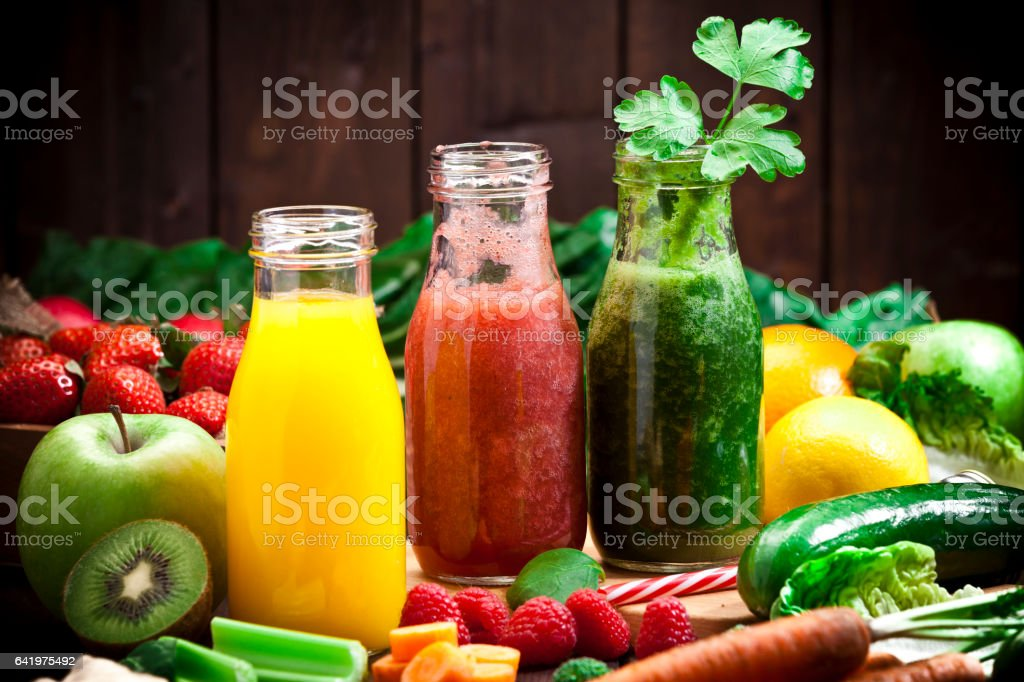 Three fruits and vegetables detox drinks stock photo