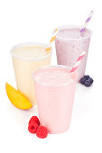 Mango, raspberry and blueberry yogurt smoothies in generic cups on a white background. These could also be milkshakes. Please see below for individual smoothie flavors and horizontal view.
