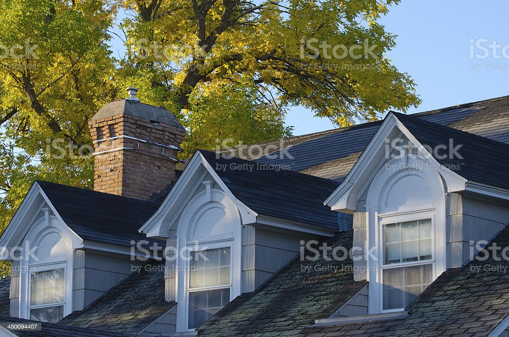 Three Gables on a Roof in the Morning stock photo