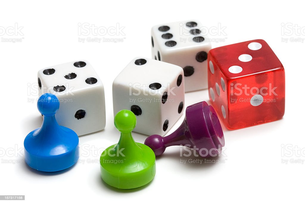 Three game pieces and four dice stock photo