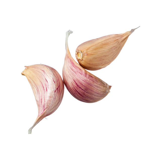 three garlic cloves isolated on white background - garlic stock photos and pictures