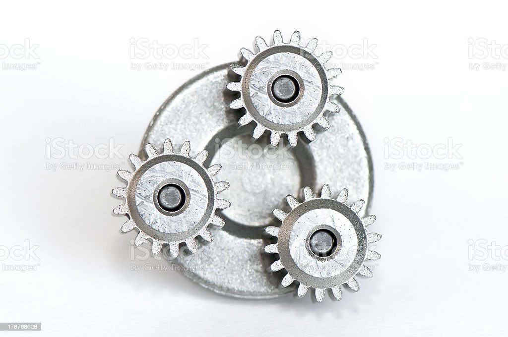 Three gears on a base royalty-free stock photo