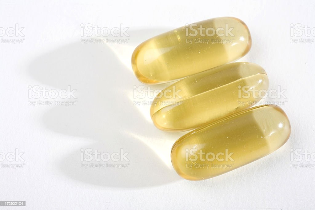 Three Gel Capsules royalty-free stock photo