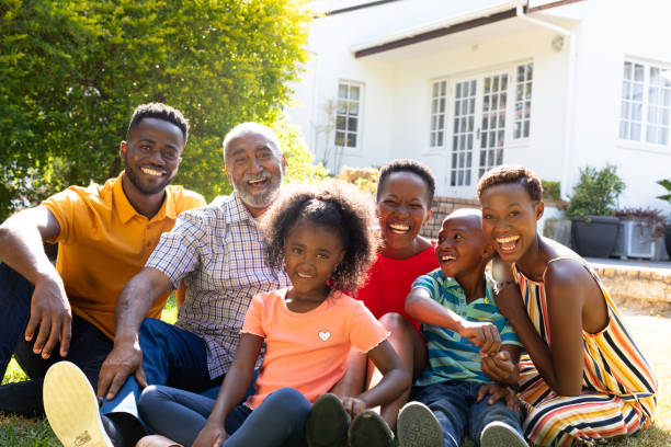 Three generation African American family spending time together in their garden. stock photo