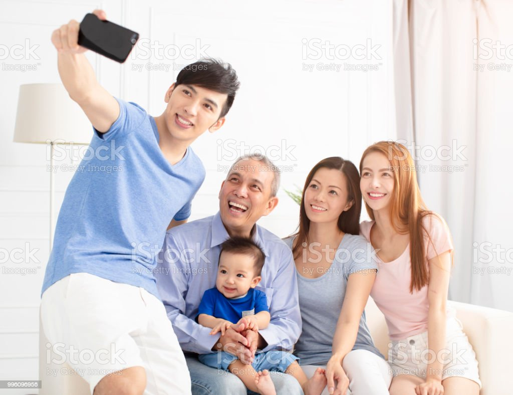 Three Generation asian Family taking selfie stock photo