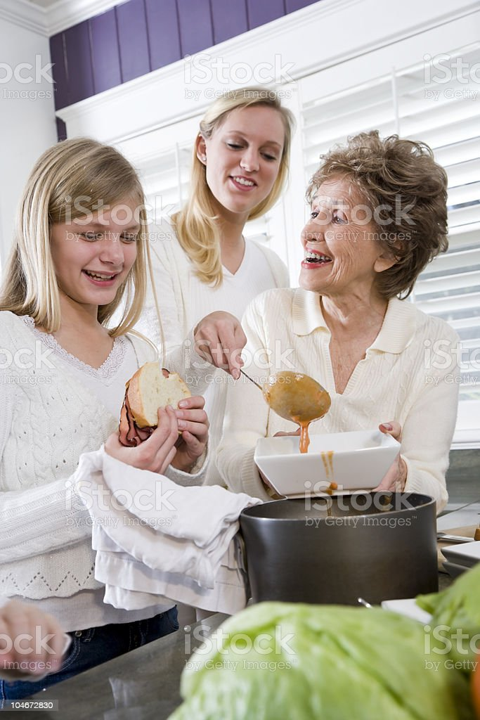 Three generation family at home serving lunch royalty-free stock photo