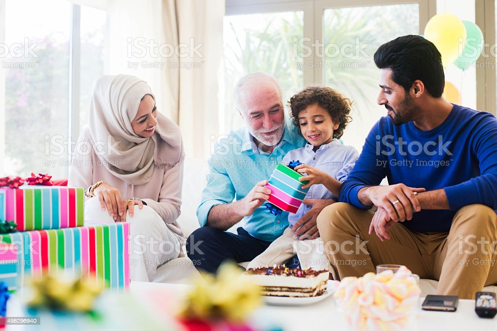 Three generation family celebrating a birthday in Dubai. stock photo