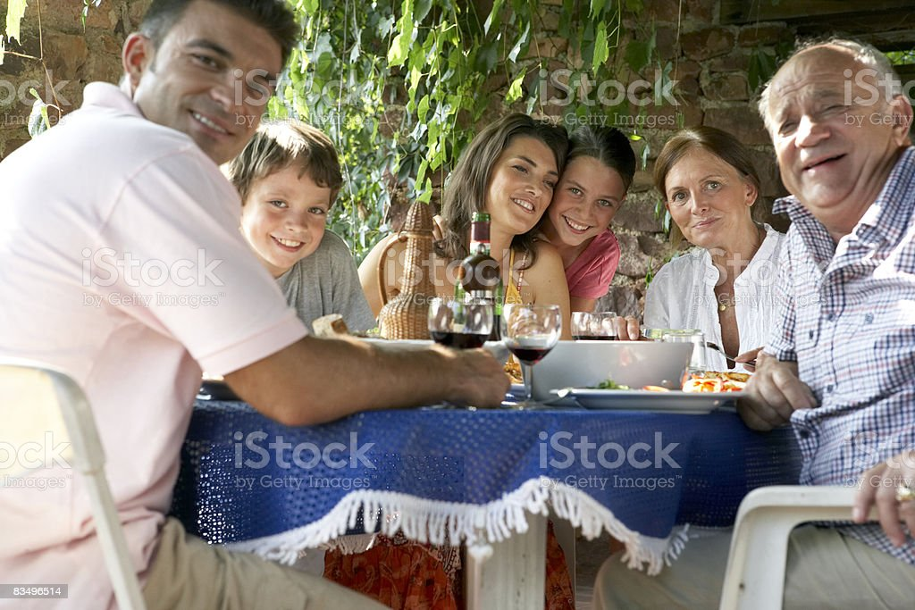 three generation family eating lunch outdoors royalty free stockfoto