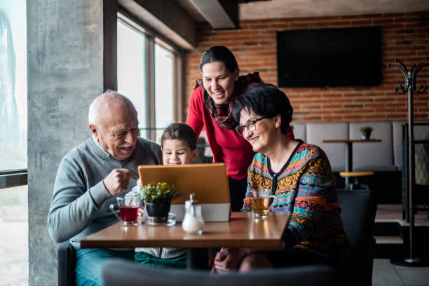 Three generation family in the cafe stock photo
