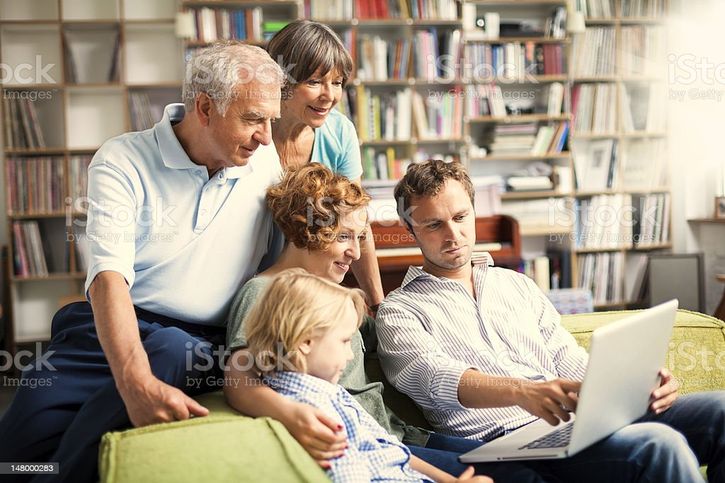 three generation family making projects together royalty-free stock photo