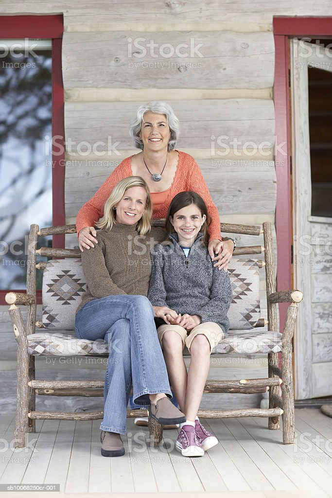 Three generation family on sofa, smiling, portrait 免版稅 stock photo
