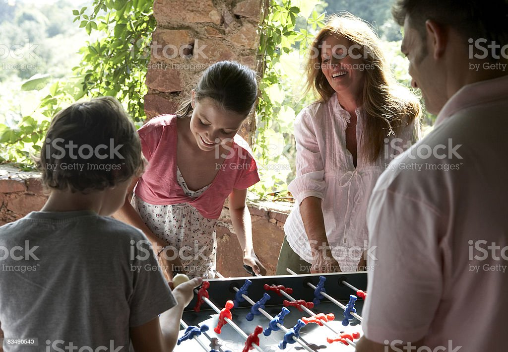 three generation family playing table football royalty-free stock photo