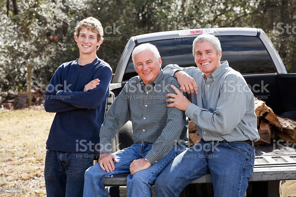Three generation family with pickup truck royalty-free stock photo