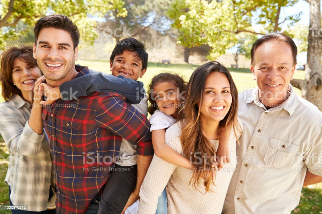 Three generation multi ethnic family portrait in a park stock photo
