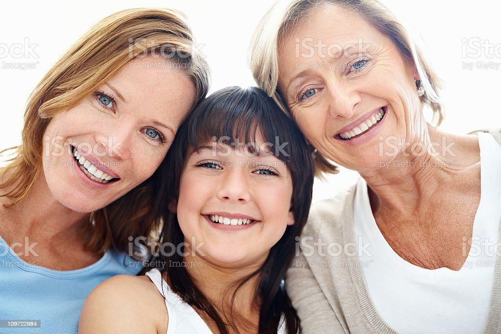 Three generational females smiling together stock photo