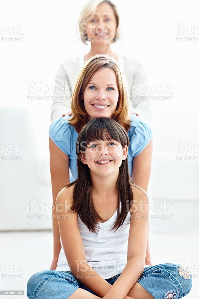 Three generational females smiling together royalty-free stock photo