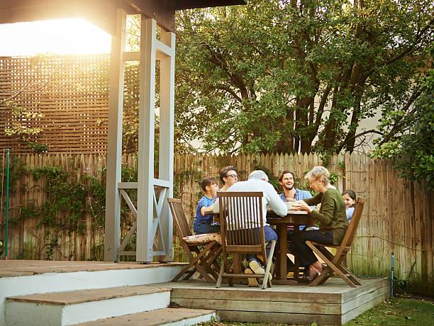 three generations gathered at the table - kleinmöbel stock-fotos und bilder