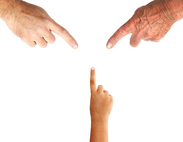 three generations of hands with pointing finger - human finger stock pictures, royalty-free photos & images