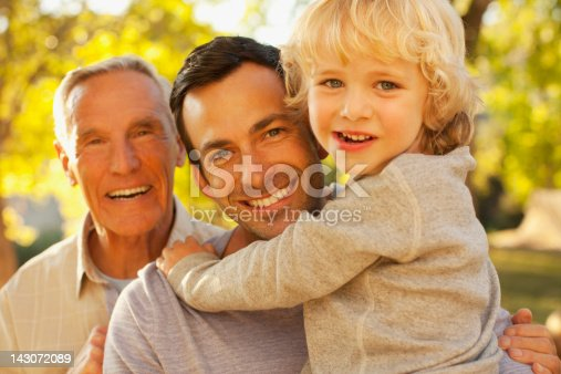 istock Three generations of men smiling together 143072089