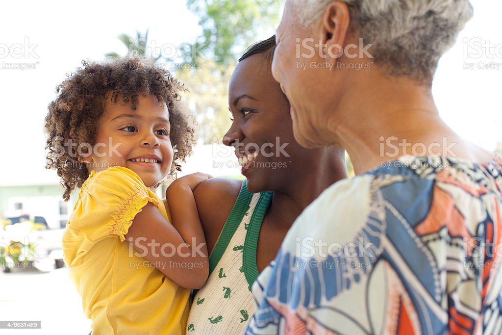 Three generations of women bonding outdoors stock photo