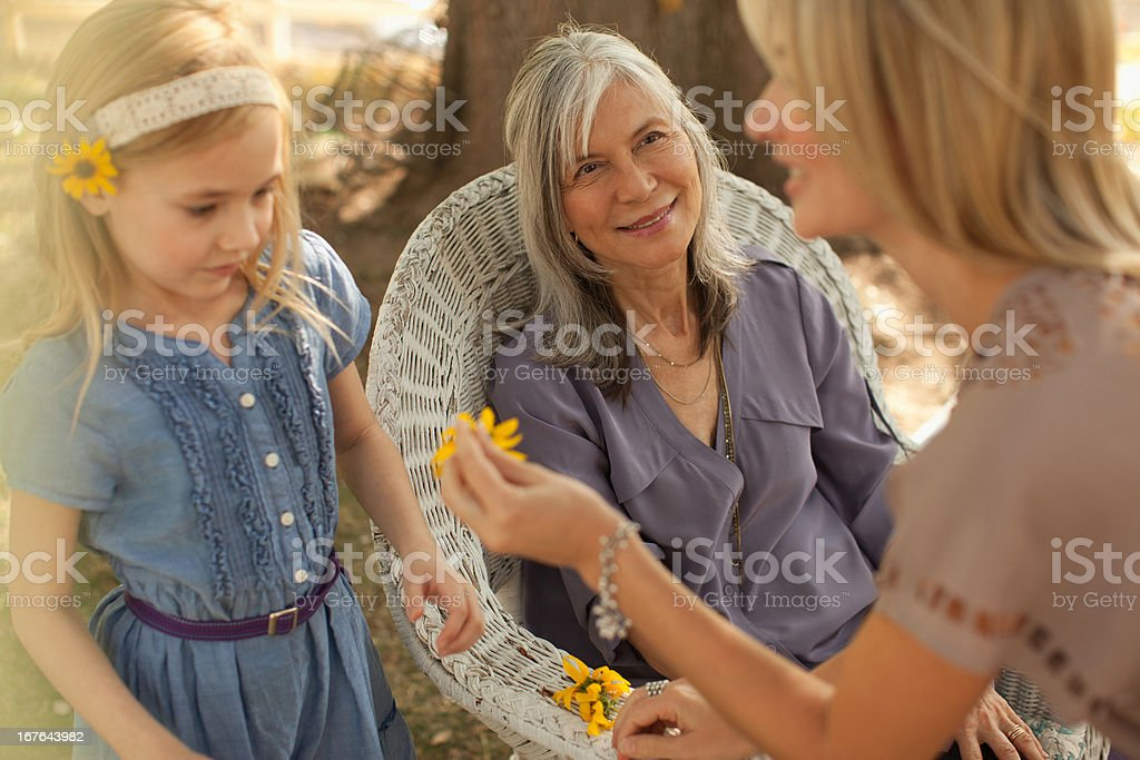 Three generations of women playing outdoors royalty-free stock photo