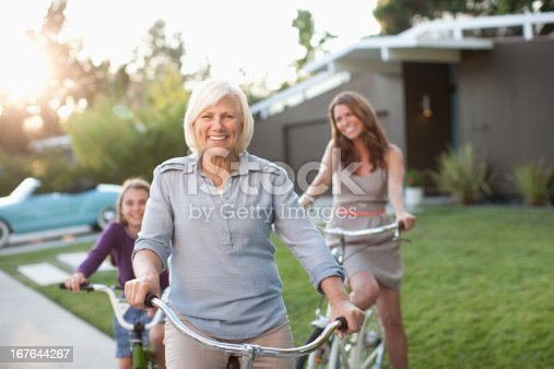 istock Three generations of women riding bicycles 167644267