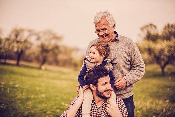 three generations - three people stock photos and pictures