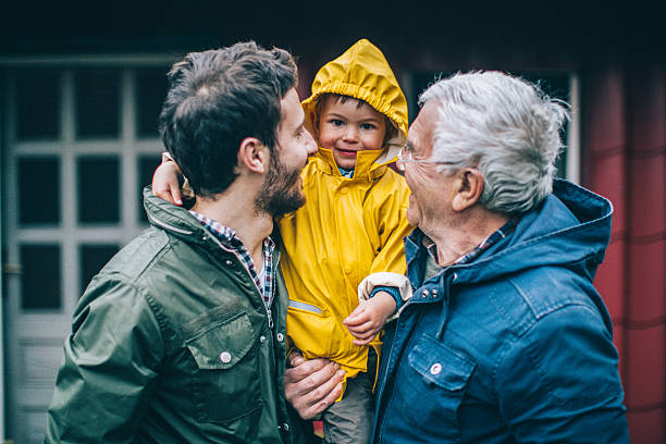 Three generations Photo of smiling little boy with his father and grandfather grandson stock pictures, royalty-free photos & images