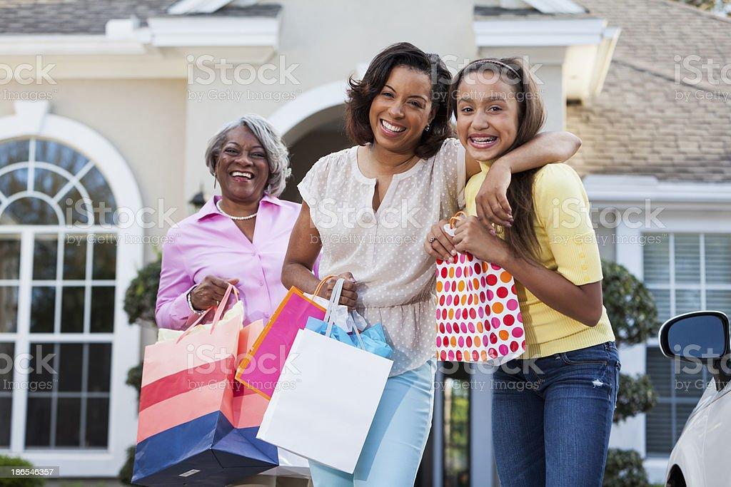 Three generations shopping stock photo