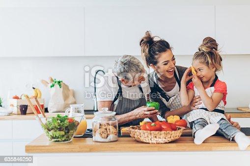 istock Three generations women in the kitchen 635846250