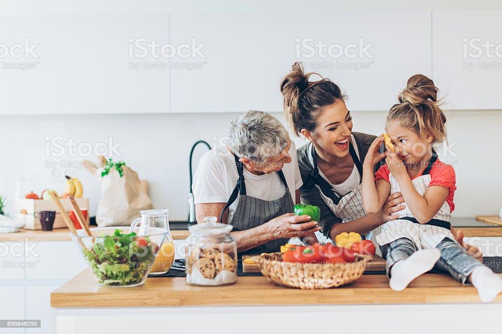 Three generations women in the kitchen - Photo