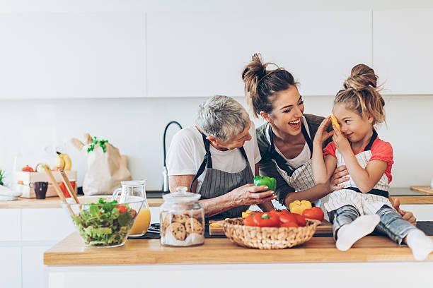 Three generations women in the kitchen - Photo