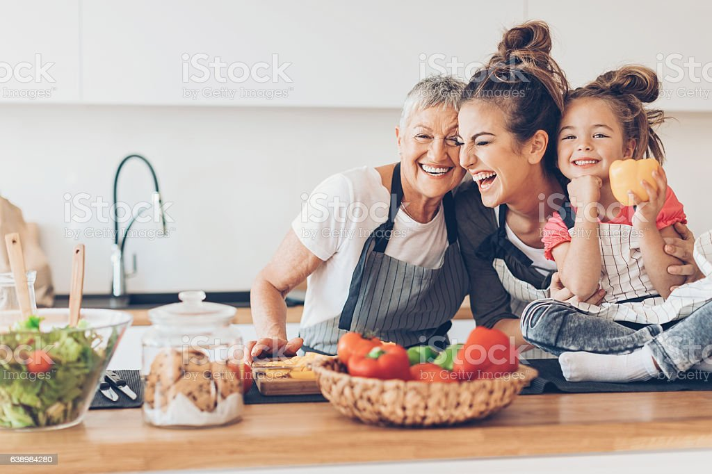 Three generations women laughing in the kitchen – Foto