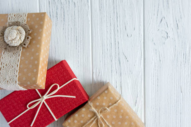 Three gifts close up on a light wooden background with a place for picture id1178423992?b=1&k=6&m=1178423992&s=612x612&w=0&h=bkory63 1wiqzvcxybh7ixv8i4zsz 2vhkn8eavidr4=