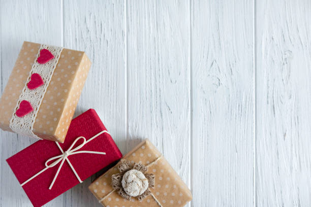 Three gifts close up on a light wooden background with a place for picture id1191114918?b=1&k=6&m=1191114918&s=612x612&w=0&h=rrjdvfdkftoyrhokyk qk7f0z8suiqxbasrxrhxorxg=