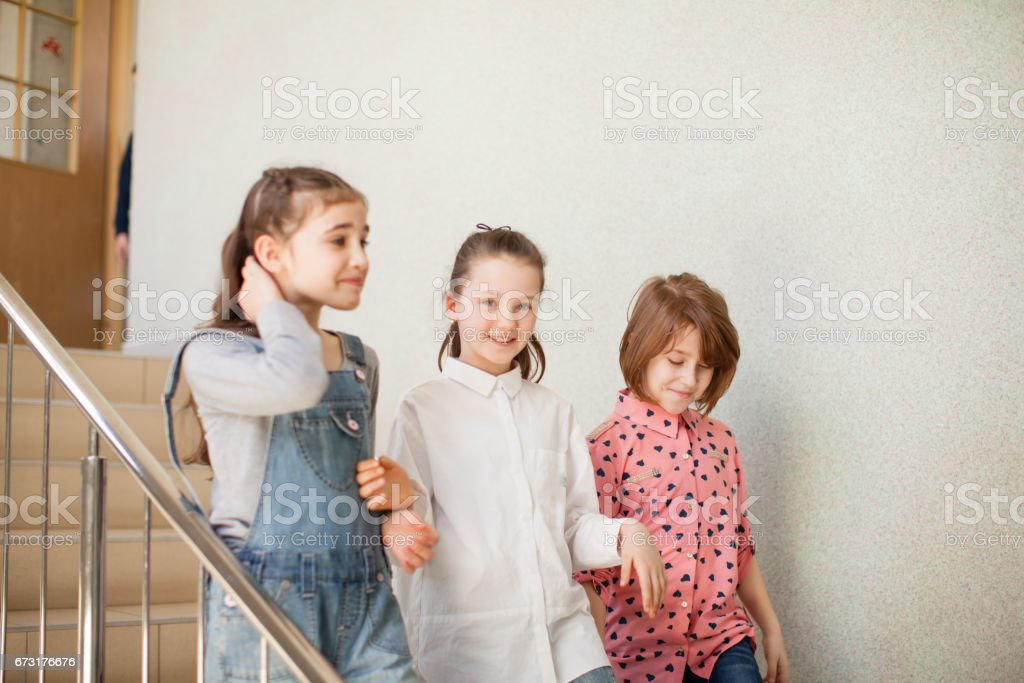 Three girlfriends after the lesson stock photo