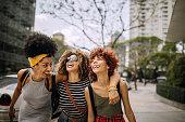 istock Three girlfriends having fun in the city 1206536770