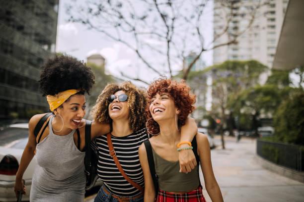 Three girlfriends having fun in the city stock photo