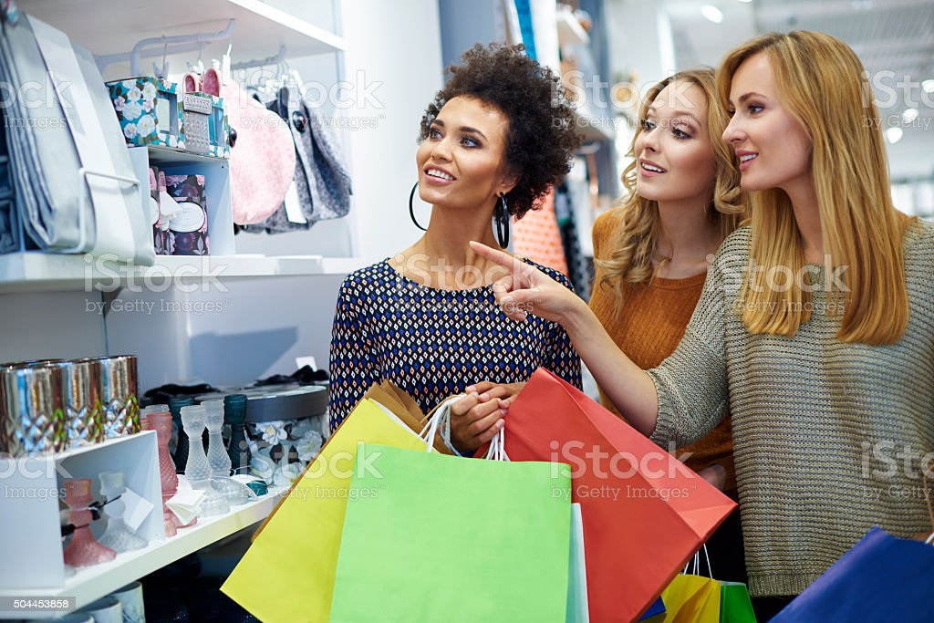 Three girls in the shop stock photo