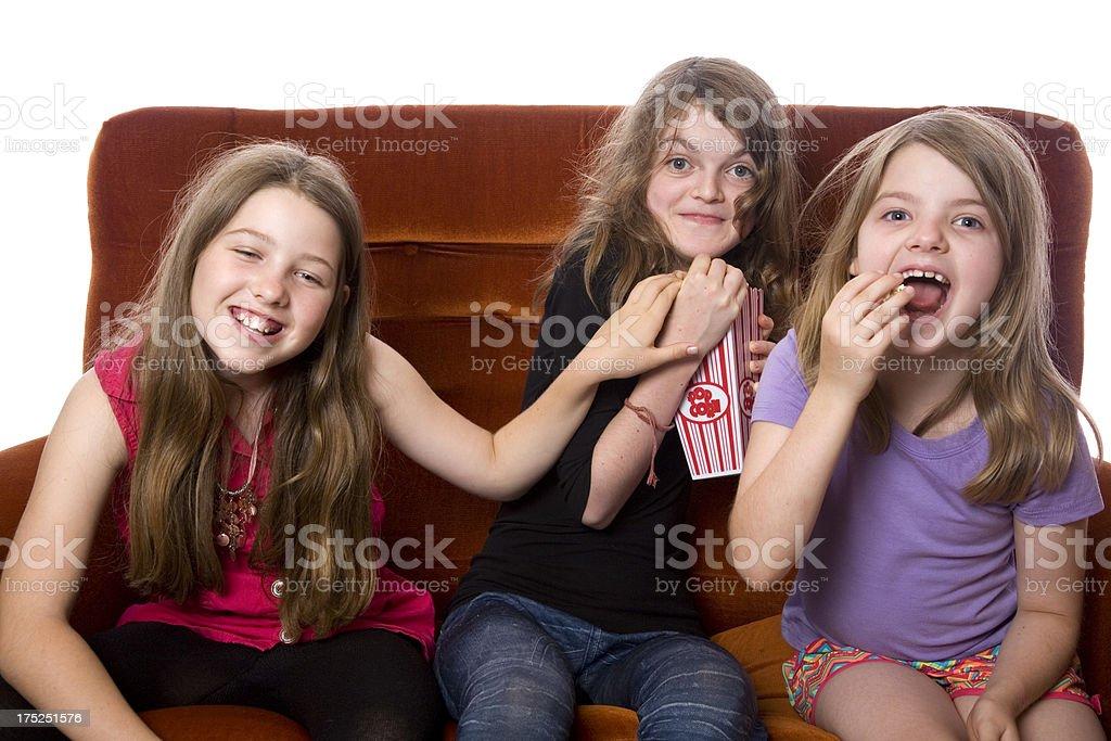 Three Girls Movie Time royalty-free stock photo