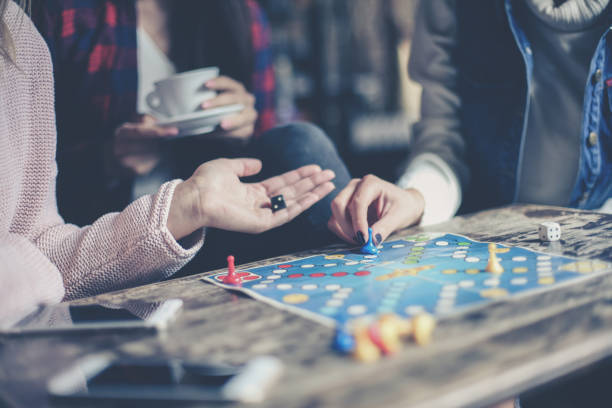 Three girls play together a social game. Focus on hand. stock photo