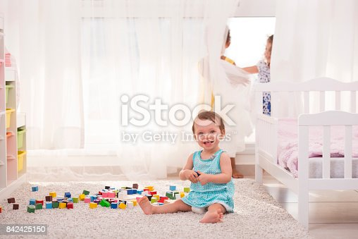 istock Three girls playing in the playroom. 842425150