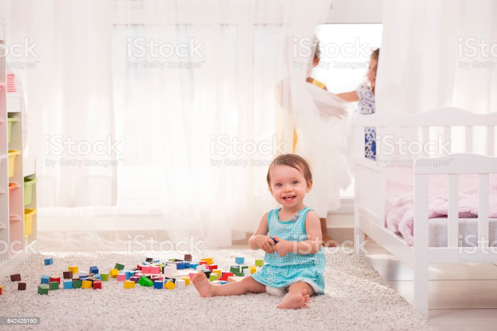 Three girls playing in the playroom. stock photo
