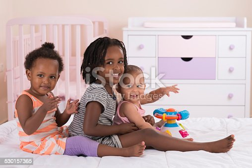 istock Three girls playing together. 530157365
