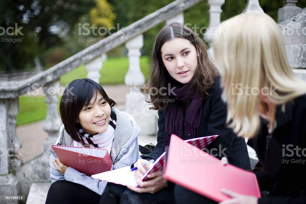Three girls studying outdoors royalty-free stock photo