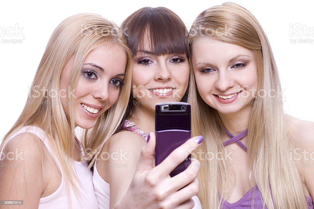 three girls with phone royalty-free stock photo